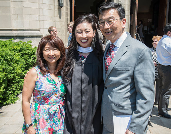 A Master's Program graduate celebrates with family