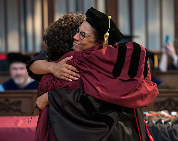 Associate Professor Gina Samuels embraces a graduate