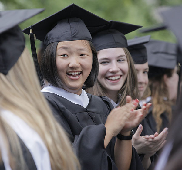 Master's students share in smiles and celebration