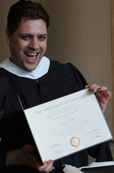 Proud Master's student shows his diploma