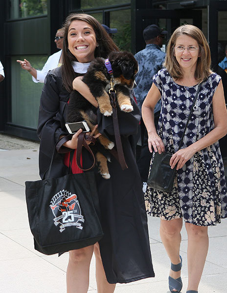 Excited graduate with her puppy