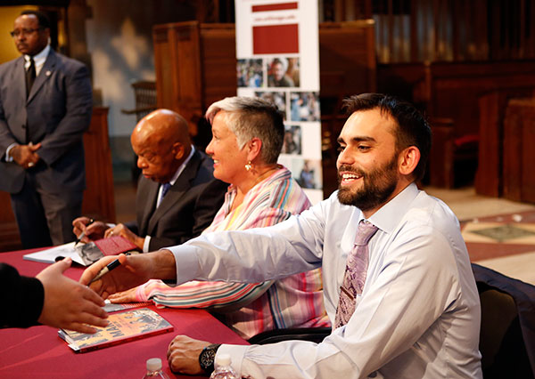 Rep. John Lewis and Andrew Aydin sign copies of their graphic novel series, March
