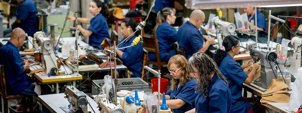 People sewing in a clothing factory