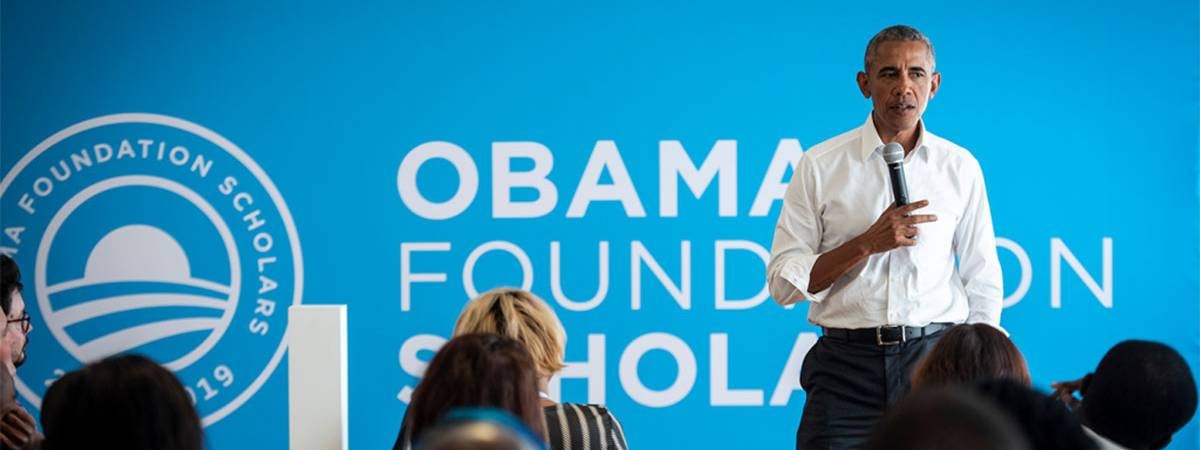 President Barack Obama talks with the inaugural class of Obama Scholars in 2018 in Chicago.