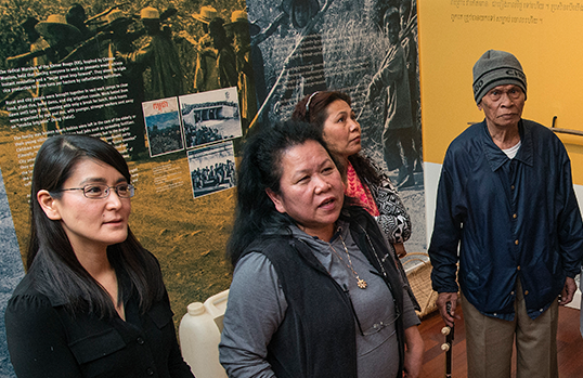 Miwa Yasui speaks with survivors of Cambodia's Killing Fields at the Cambodian Association of Illinois' Museum.