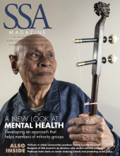 """SSA cover featuring an older, male-presenting man with an instrument with title: """"A New Look at Mental Health."""""""