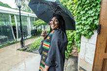 Graduate in the rain before the 2018 Graduation and Hooding Ceremony and celebration
