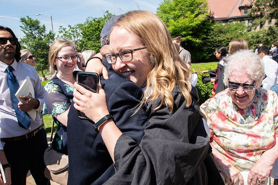 Graduates celebrate with families and friends after the hooding ceremony