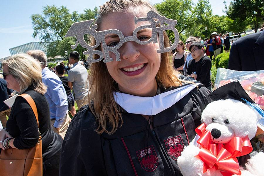 Master's graduate celebrates after the hooding ceremony
