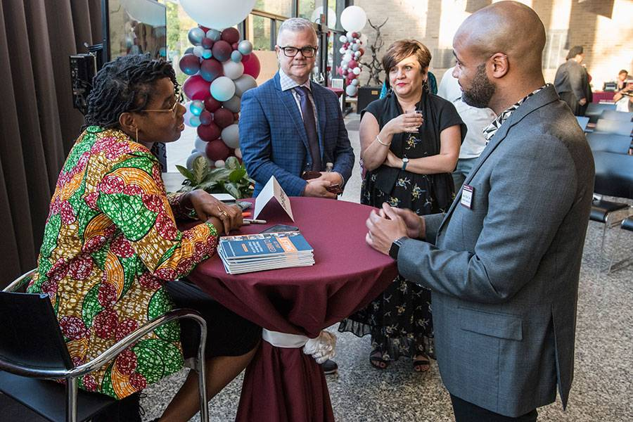 Essence McDowell signs her book for alumni at the 2019 Social Justice Address