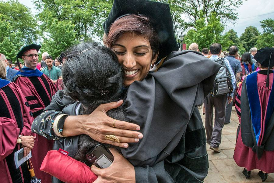 Graduate and Instructor celebrate after the 2018 Graduation and Hooding Ceremony