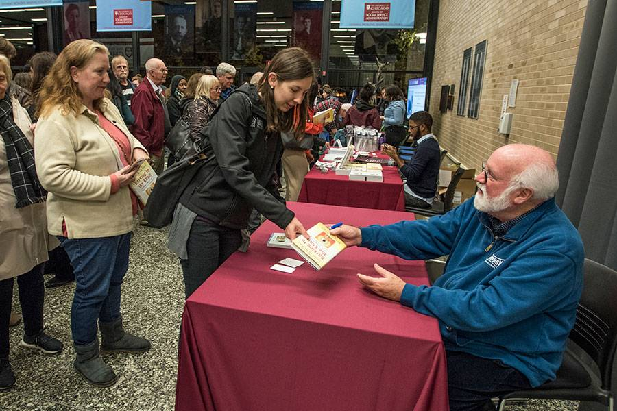Gregory Boyle meets audience members after the lecture