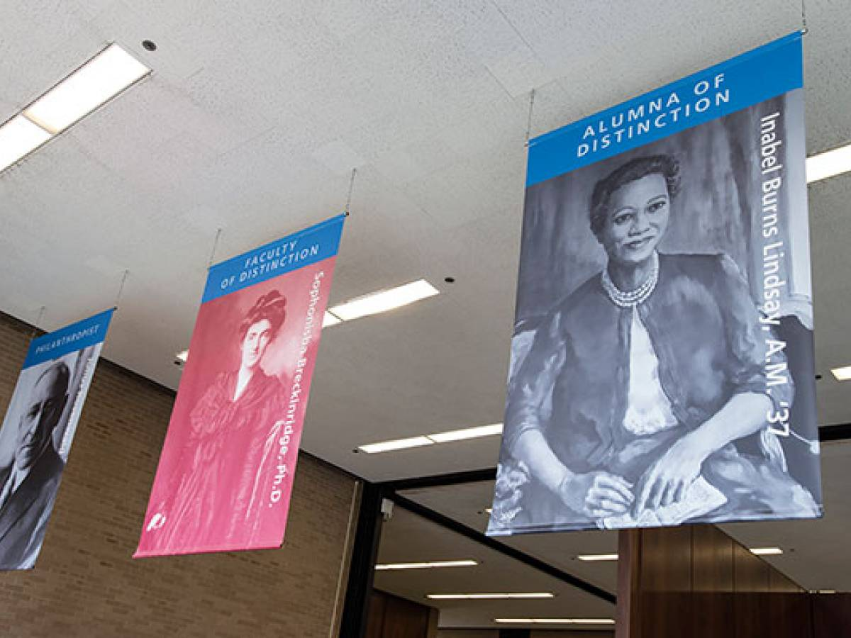 Banner of honoree Inabel Burns Lindsay, AM '37, hung in SSA lobby alongside other leaders of SSA and the social work field