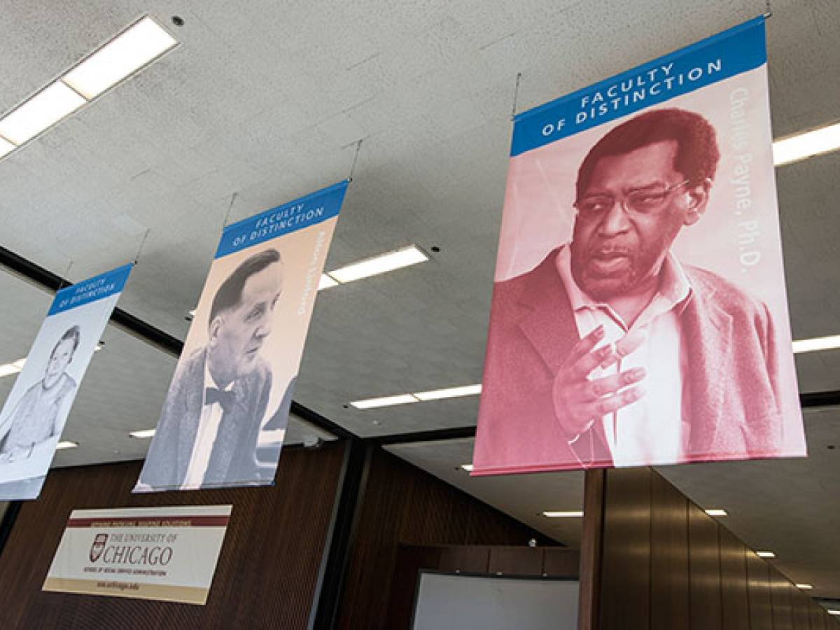 Banner of honoree Charles Payne hung in SSA lobby alongside other leaders of SSA and the social work field