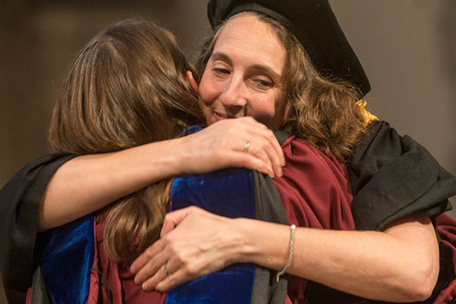 Associate Professor Julia Henly embraces a Doctoral student