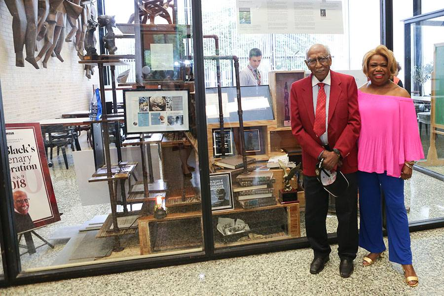 Timuel D. Black Jr. next to his display in the SSA library