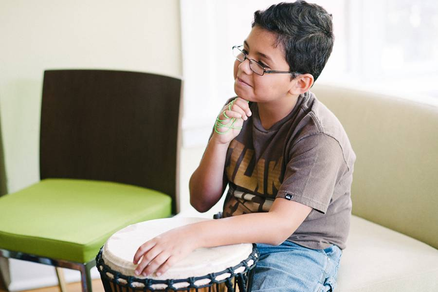 Boy at Valerie Guerra's music therapy project