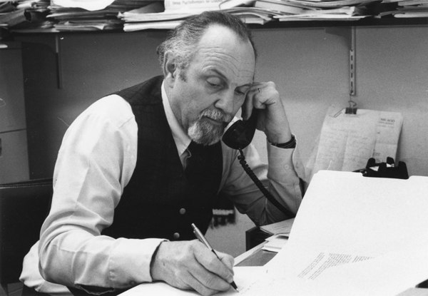 Paul Gitlin on the phone at his desk